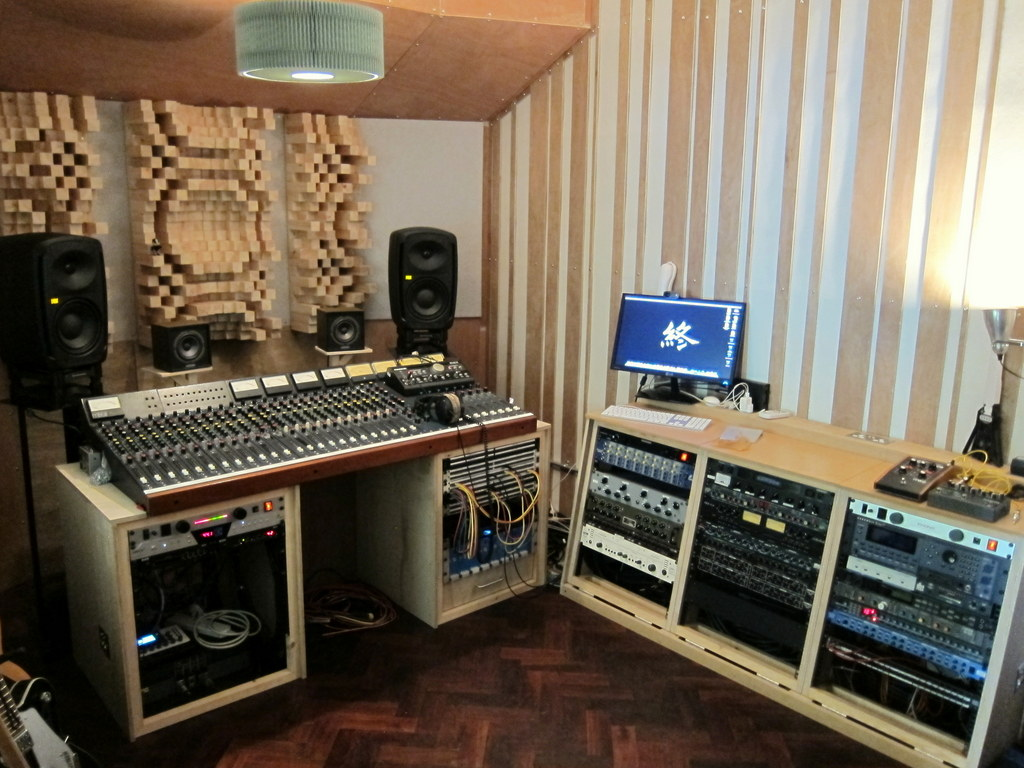 Triple rack bay on the right with Primitive Root 'phase grating' treatment behind - Quadratic Residue Diffusers behind desk mounted over sideband absorbers